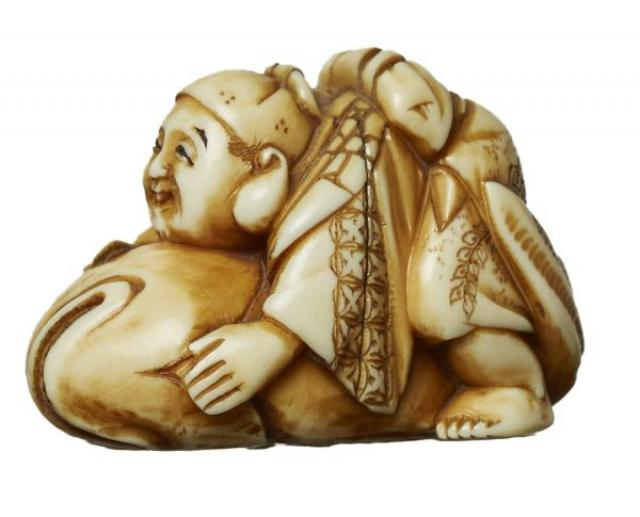 Signed - Netsuke - Boy riding a Fish